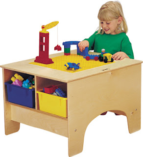 child's LEGO building table with storage bins