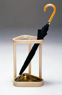 umbrella stand in birch with brass tray, designed by Alvar  Aalto