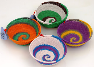 colorful bowls made from telephone wire