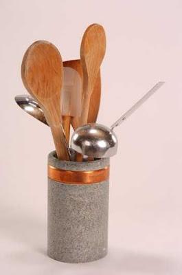 soapstone utensil jar holding wooden spoons, etc.