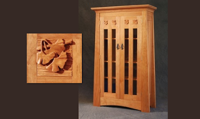 bookcase with doors and fancy wood carving