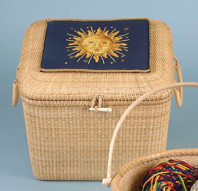 filing basket with sun design needlework square on top