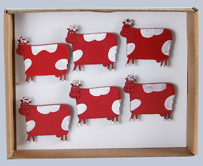 magnets shaped like cows, red and white