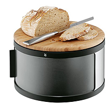 round bread box with cutting board on the top