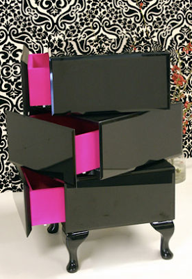 revolving cabinet, black with pink interior