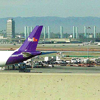 FedEx Plane, the old Tower and the light column art thing at LAX (c) David Ocker
