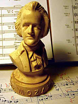 a plastic statuette of Wolfgang Amadeus Mozart