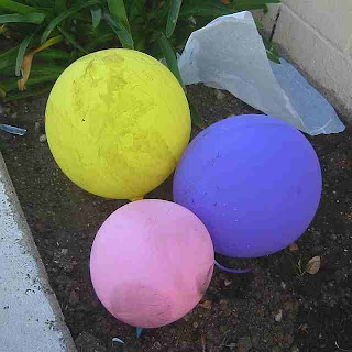 3 dirty, lonely pastel balloons