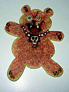 Goth teddy bear cookie with skull