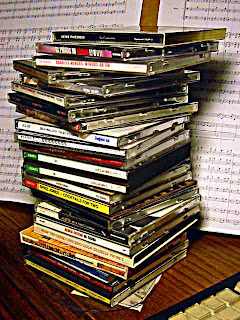 stack of compact discs on my desk ready for iPod insertion