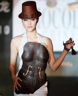 model wearing chocolate breastplate