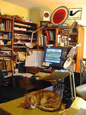 My cluttered actual desk - not where I compose