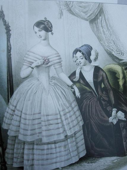 Queen Victoria Hairstyles. The model on the left has a typical 1840's