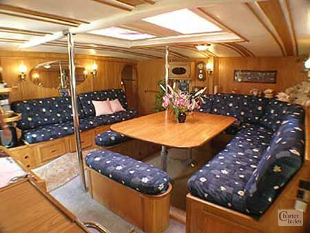 The two forward cabins are doubles, while the aft two guest cabins have ...