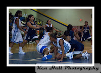 Jakia Davis (15) and Whitney Harrington (25) dive for the loose ball