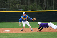 Connor Torruella applies the tag