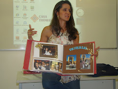 Cynthia shares her scrapbooks with the class. What a talented artist!