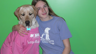 Picture of Toby & I, Toby is wearing my pink shirt which says puppy raiser, it has 7 cute puppies which say we are future guide dogs! I'm wearing the same shirt (but in blue, and you can see the front not the back), it says Southeastern Guide Dogs