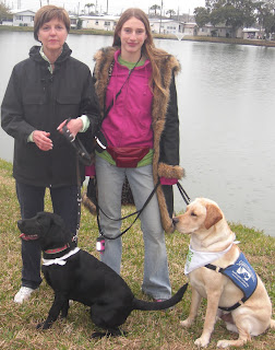 Toby and I with Ellen and Bingo.  Ellen is a PR in our group, Bingo's a female black lab.  The lake is the background