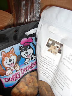 Picture of the treats Toby received, 2 treat bags & a beef jerky stick!