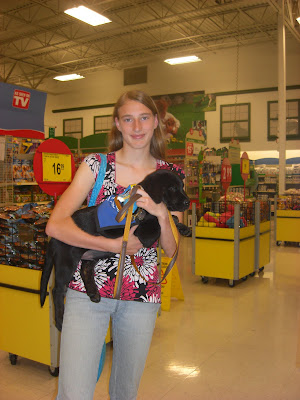 Picture of me holding Rudy in petsmart.  I'm wearing the same shirt that I wore when I picked up/dropped off Toby