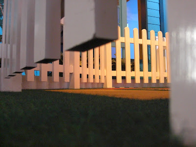 Picture of my photography class assignment (taken from a worms eye view - of a white fence)