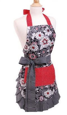 Picture of the women's apron up for giveaway; it is trimmed with black/white striped & has a flowery print