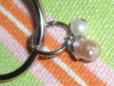 Up close picture of just the charm; 2 wonderful looking pearls - 1 white & 1 pale pink