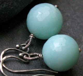 Hand crafted earrings featuring faceted Amazonite rounds with hand coiled bails of oxidized sterling silver