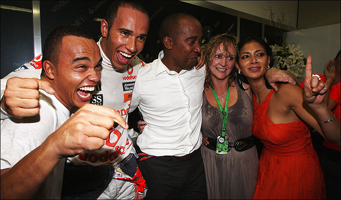 Brother Nic, Lewis Hamilton, Dad Anthony, Stepmom Linda and Pussy Dolls girlfriend Nicole Scherzinger celebrate the F1 Championship