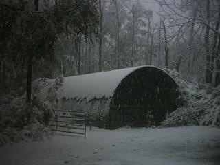 Snow on Quonset hut.