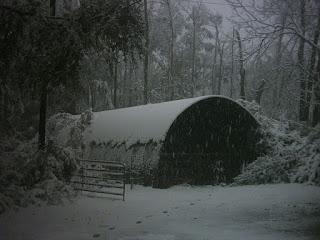 Snow on Quonset hut.