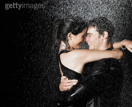 romantic couple kissing in the rain. kissing, hugging and