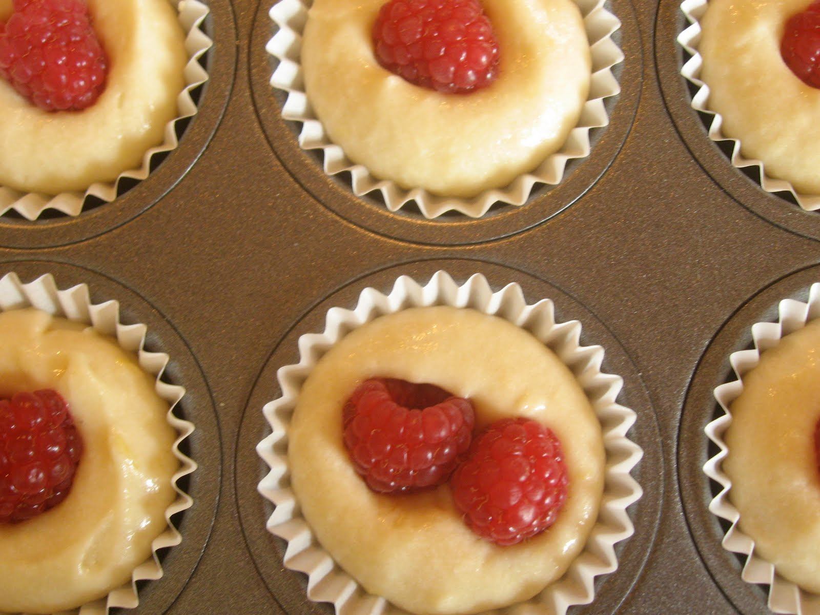 The Dirty Oven: Raspberry Topped Lemon Muffins.