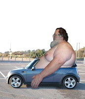 http://3.bp.blogspot.com/_u7LnAXyVfww/SkADXE8cjtI/AAAAAAAAAF8/Uio188eE7hQ/s400/225629_fat_guy_in_car.jpg