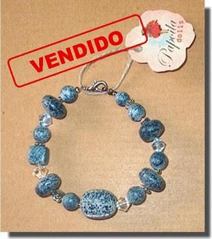 pulseira azul bolas