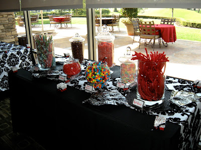 Candy by Brandi multicolored candy buffet setup for a black white and red