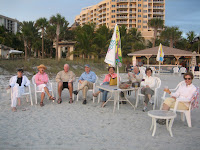 Sarasota real estate owners and customer on beach at Lido Key