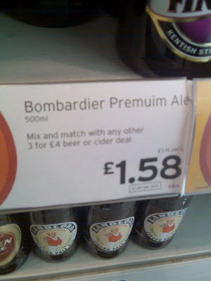 A supermarket price sign for Bombardier Premuim Ale