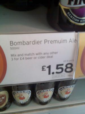 A supermarket price sign for Bombardier Premuim Ale