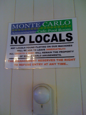 Sign saying NO LOCALS