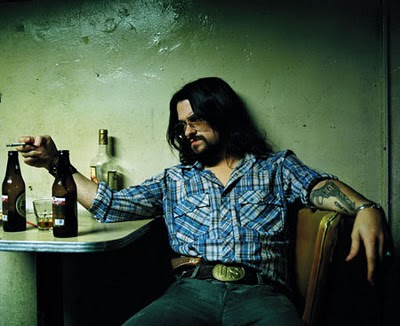 Shooter Jennings Gun Tattoo Design on Forearms