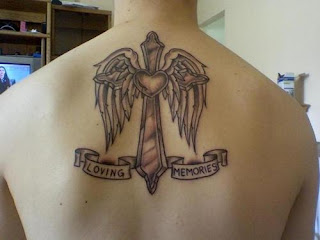 Cross Tattoo design with wings and heart
