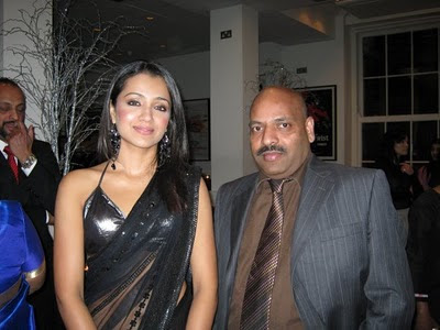 Trisha in Black transparent saree with bikini style blouse