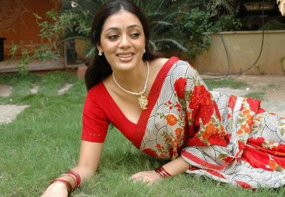 Parvathi Melton in red printed saree