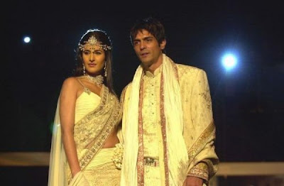 Katrina Kaif and Arjun Rampal in wedding costumes