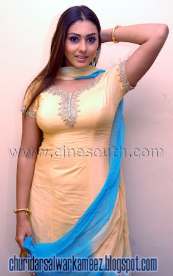 Actress Namitha in plain Yellow Churidar dress