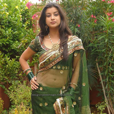 Actress Madhurima in Transparent Green Saree still