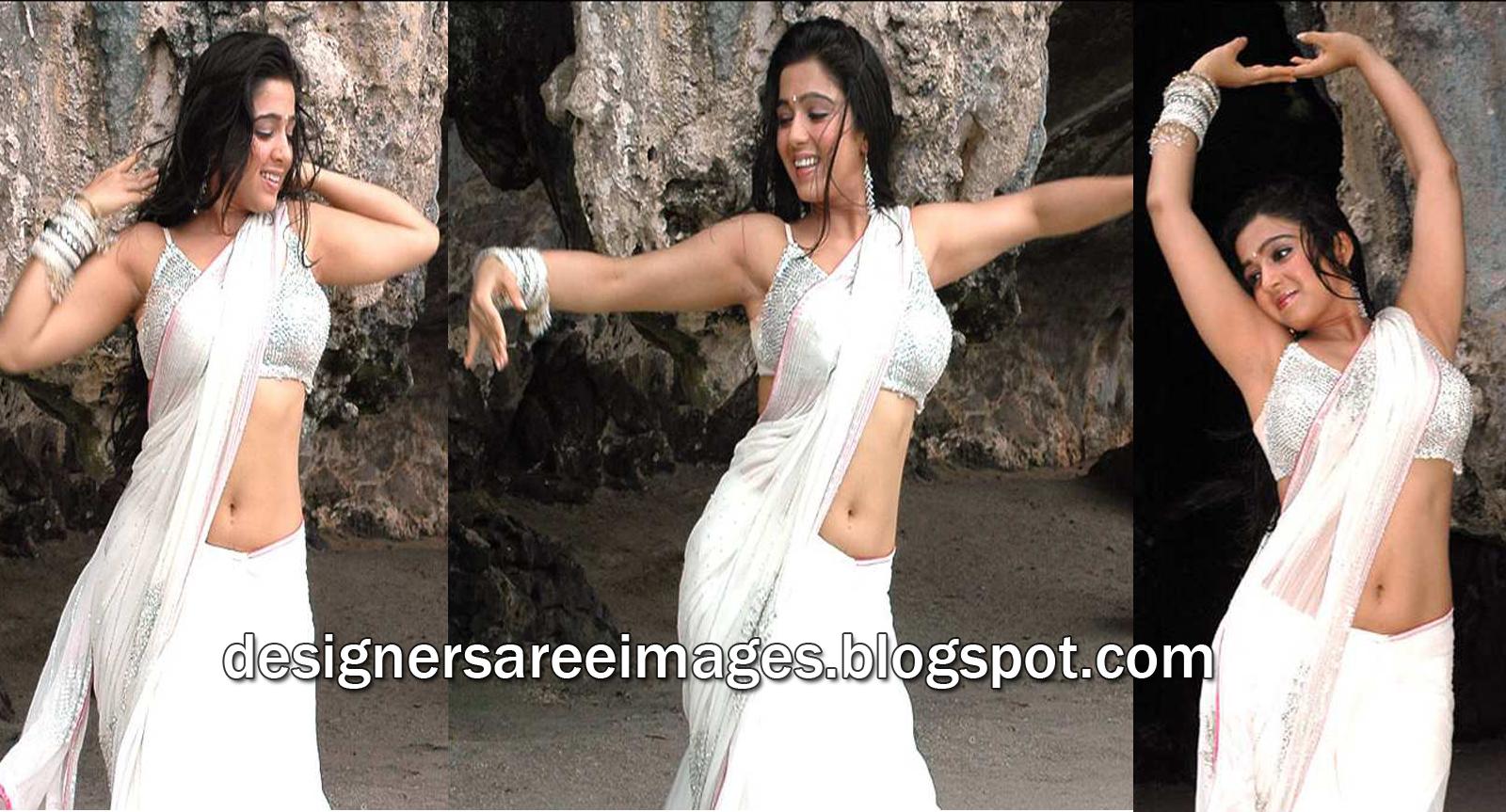 Charmi in White Saree and Sleeveless Designer Sari Blouse