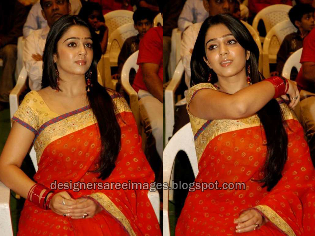 Actress Charmi in Red Designer Saree photo
